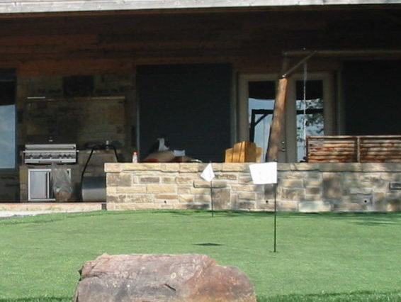 Putting Green in a back yard with Synthetic Turf